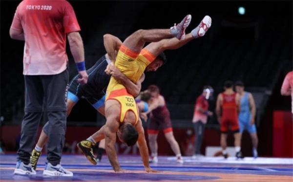 رقیب المپیکی محمدرضا گرایی نشان افتخار گرفت